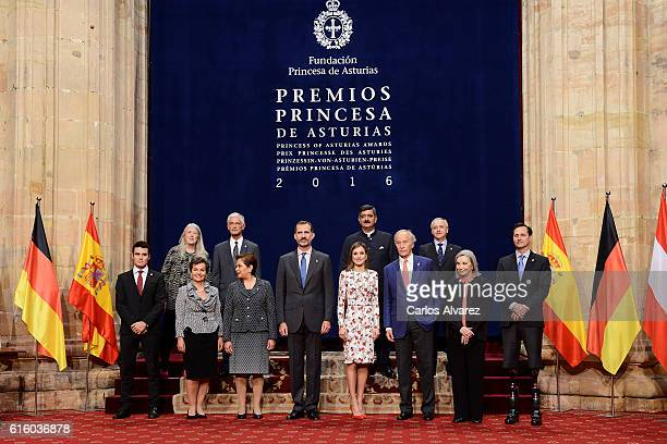 King Felipe VI of Spain and Queen Letizia of Spain pose for a picture with the 2016 Princess of Asturias Award laureates at the Reconquista Hotel...