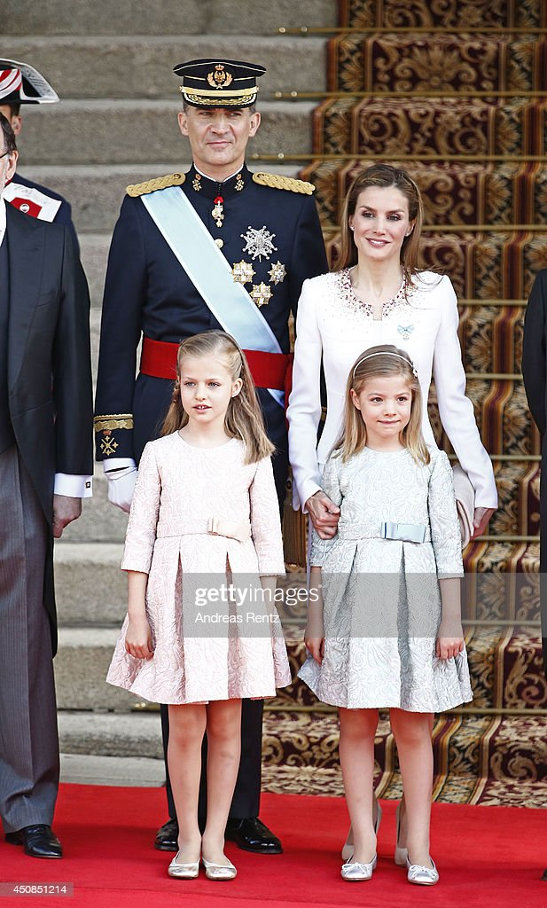 King <a gi-track='captionPersonalityLinkClicked' href=/galleries/search?phrase=Felipe+VI+of+Spain&family=editorial&specificpeople=4881076 ng-click='$event.stopPropagation()'>Felipe VI of Spain</a> and Queen <a gi-track='captionPersonalityLinkClicked' href=/galleries/search?phrase=Letizia+of+Spain&family=editorial&specificpeople=158373 ng-click='$event.stopPropagation()'>Letizia of Spain</a> pose with daughters Princess <a gi-track='captionPersonalityLinkClicked' href=/galleries/search?phrase=Leonor+-+Princess+of+Asturias&family=editorial&specificpeople=6328965 ng-click='$event.stopPropagation()'>Leonor</a>, Princess of Asturias and Princess Sofia infront of the Lions Gate at the Congress of Deputies during the King's official coronation ceremony on June 19, 2014 in Madrid, Spain. The coronation of King Felipe VI is held in Madrid. His father, the former King Juan Carlos of Spain abdicated on June 2nd after a 39 year reign. The new King is joined by his wife Queen <a gi-track='captionPersonalityLinkClicked' href=/galleries/search?phrase=Letizia+of+Spain&family=editorial&specificpeople=158373 ng-click='$event.stopPropagation()'>Letizia of Spain</a>.