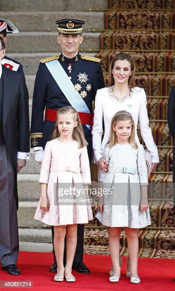 King Felipe VI of Spain and Queen Letizia of Spain pose with daughters Princess Leonor Princess of Asturias and Princess Sofia infront of the Lions...