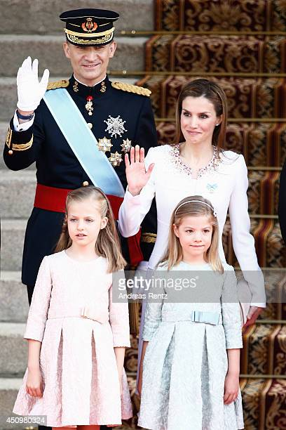 King Felipe VI of Spain and Queen Letizia of Spain pose with daughters Princess Leonor Princess of Asturias and Princess Sofia at the Lions Gate the...