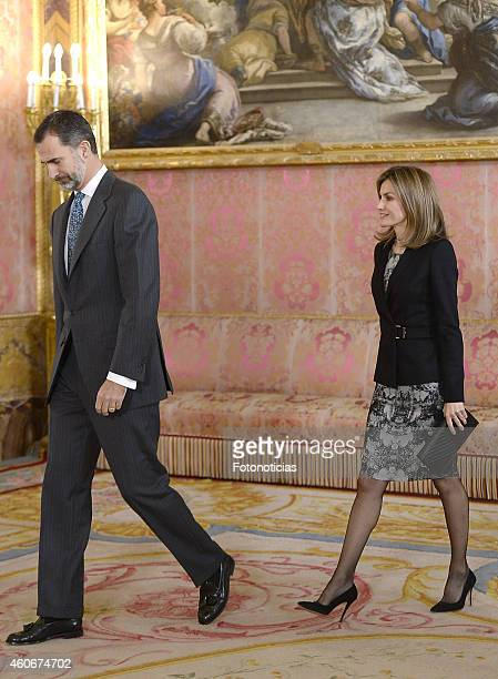 King Felipe VI of Spain and Queen Letizia of Spain receive members of the 'Principe de Girona' Foundation at The Royal Palace on December 19 2014 in...