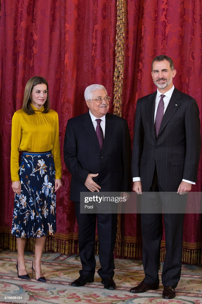 King Felipe VI of Spain (R) and Queen Letizia of Spain (L) receives Palestinian President Mahmoud Abbas (C) at the Royal Palace on November 20, 2017 in Madrid, Spain.