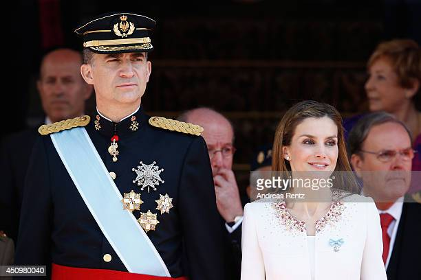 King Felipe VI of Spain and Queen Letizia of Spain review walk past a guard of Honor at the Congress of Deputies during the King's official...