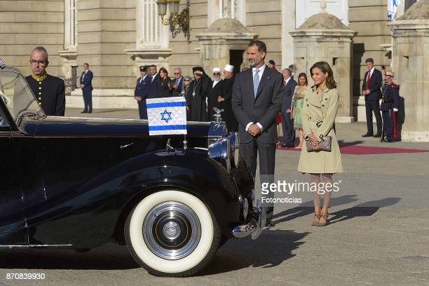 King Felipe VI of Spain and Queen Letizia of Spain wait to receive Israeli President Reuven Rivlin and wife Nechama Rivlin at the Royal Palace on...