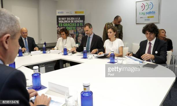 King Felipe VI of Spain and Queen Letizia sit with Minister of Health Dolors Montserrat and State for Social Services and Equality Mario Garcés...