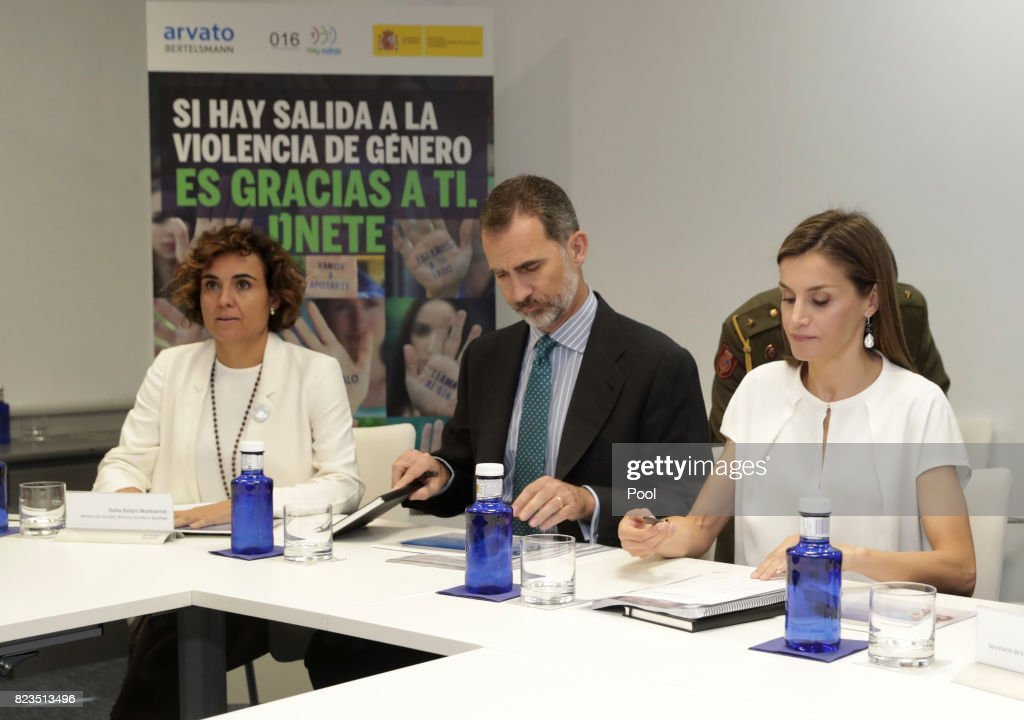 King Felipe VI of Spain and Queen Letizia sit with Minister of Health, Dolors Montserrat, during a visit to the offices of the 016 Telefonic hotline for gender violence assistance on July 27, 2017 in Madrid, Spain.