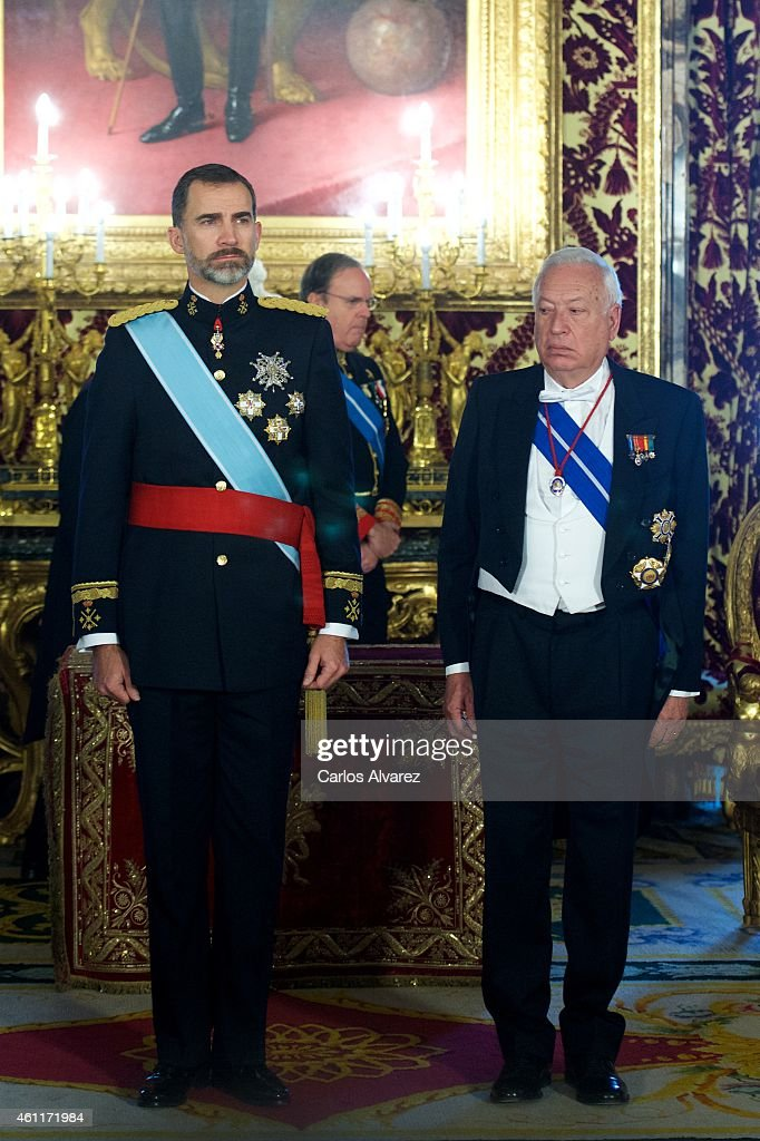 King Felipe VI of Spain (L) and Spanish Foreign Minister Jose Manuel Garcia-Margallo (R) observes a minute of silence in memory of the victims of the attack to French satirical weekly Charlie Hebdo at the Royal Palace on January 8, 2015 in Madrid, Spain.