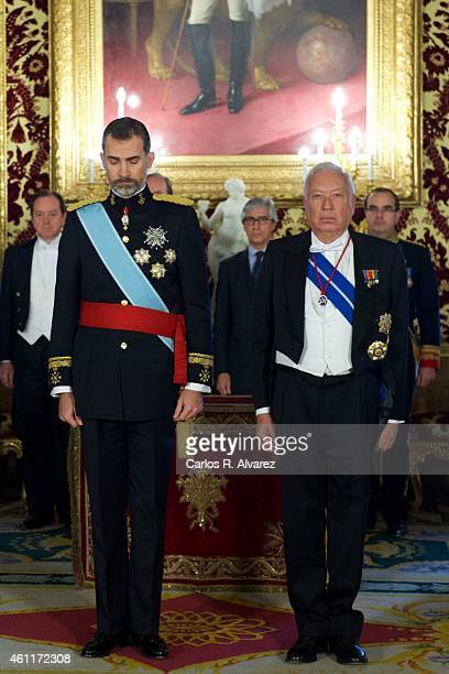 King Felipe VI of Spain and Spanish Foreign Minister Jose Manuel GarciaMargallo observes a minute of silence in memory of the victims of the attack...