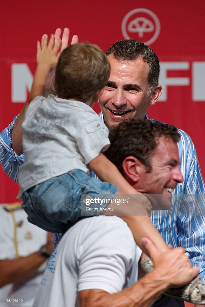 King <a gi-track='captionPersonalityLinkClicked' href=/galleries/search?phrase=Felipe+VI+of+Spain&family=editorial&specificpeople=4881076 ng-click='$event.stopPropagation()'>Felipe VI of Spain</a> (C) attends the 33th Copa del Rey Mapfre Sailing Cup Awards celebration at the Ses Voltes Cultural Center on August 9, 2014 in Palma de Mallorca, Spain.