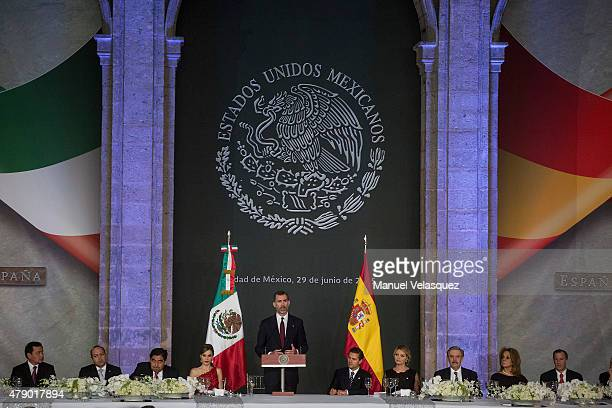 King Felipe VI of Spain gives a speech during a state dinner given by Mexican President Enrique Peña Nieto and his wife First Lady Angelica Rivera at...