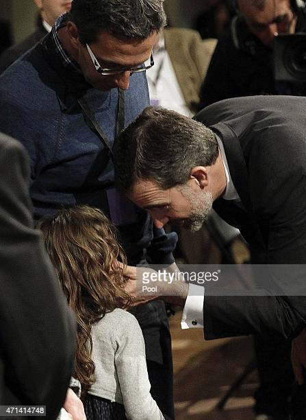 King Felipe VI of Spain gives his condolences to victim's relatives as he attends the state funeral service for the victims of the Germanwings plane...