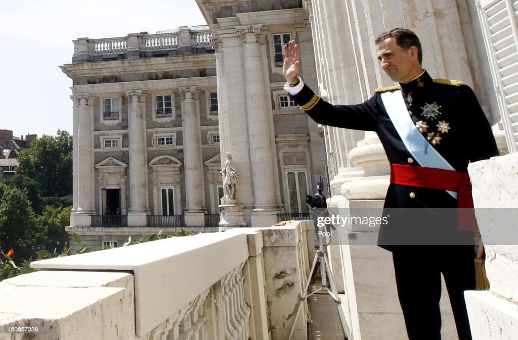 King Felipe VI of Spain greet crowds of wellwishers as he appears on the balcony of the Royal Palace during the King's official coronation ceremony on June 19, 2014 in Madrid, Spain. The coronation of King Felipe VI is held in Madrid. His father, the former King Juan Carlos of Spain abdicated on June 2nd after a 39 year reign. The new King is joined by his wife Queen Letizia of Spain.