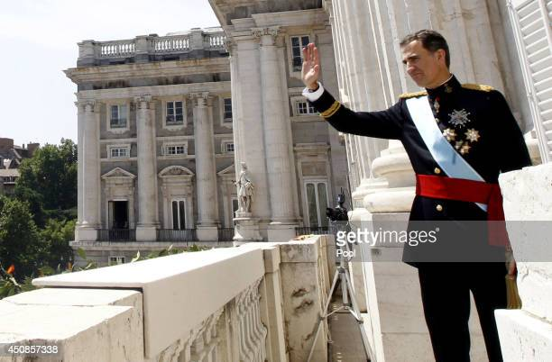 King Felipe VI of Spain greet crowds of wellwishers as he appears on the balcony of the Royal Palace during the King's official coronation ceremony...
