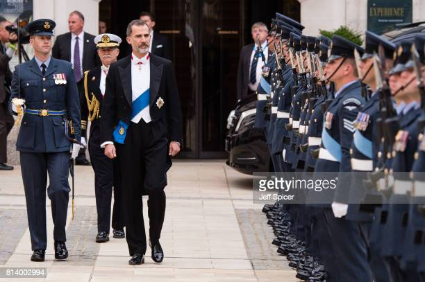 King Felipe VI of Spain inspects a Guard of Honour before the Lord Mayor's Banquet at the Guildhall during a State visit by the King and Queen of...