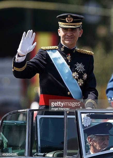 King Felipe VI of Spain makes the journey to Royal Palace after the King's official coronation ceremony at Cibeles square on June 19 2014 in Madrid...