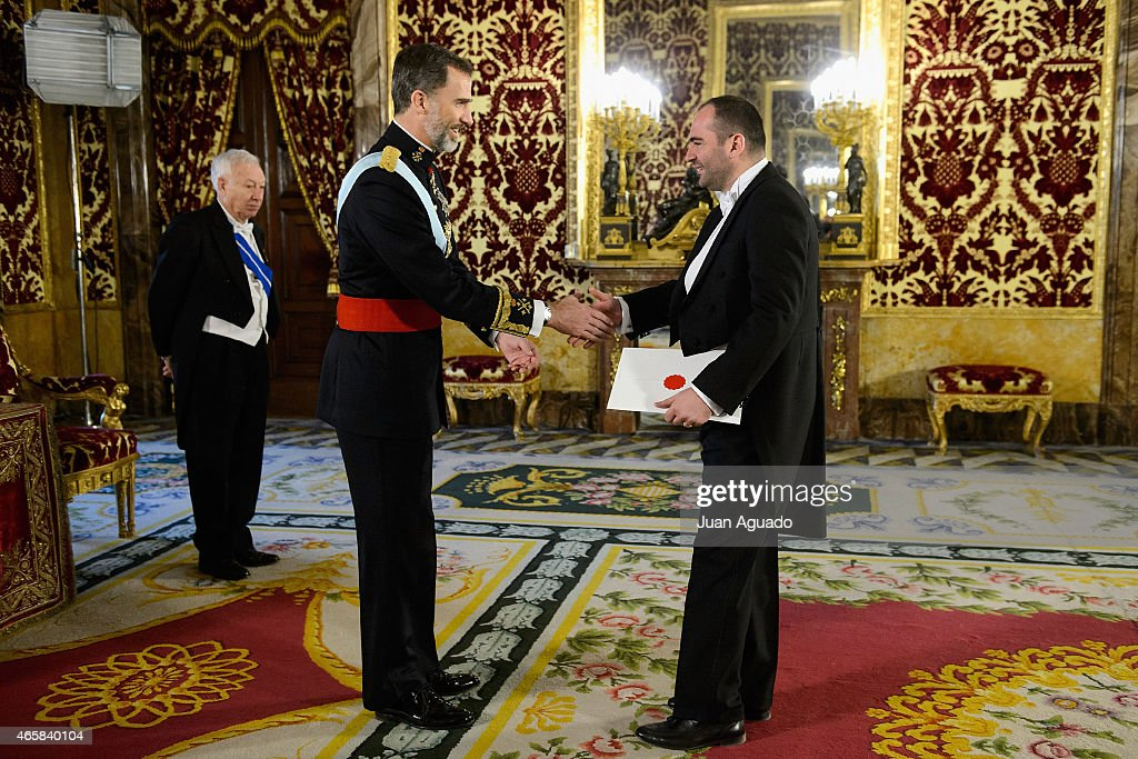 King Felipe VI of Spain (C) meets Ambassador of the Albanian Republic Ridi Kurtezi (R) at The Royal Palace on March 11, 2015 in Madrid, Spain.