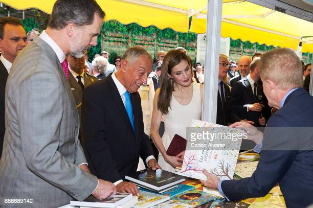 King Felipe VI of Spain Portuguese President Marcelo Rebelo de Sousa and Queen Letizia of Spain attend the Books Fair 2017 at the Retiro Park on May...