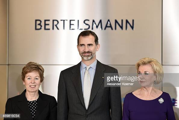 King Felipe VI of Spain poses for a photo with Dr Angelica SchwallDueren and Liz Mohn during a visit to the Corporate Center of Bertelsmann on...