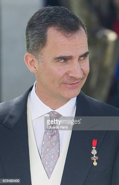 King Felipe VI of Spain poses for photographers at the University of Alcala de Henares for the Cervantes Prize award ceremony on April 23 2016 in...