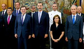 King Felipe VI of Spain poses with the Prime Minister Mariano Rajoy the vice president Soraya Saenz de Santamaria the Minister of Justice Rafael...