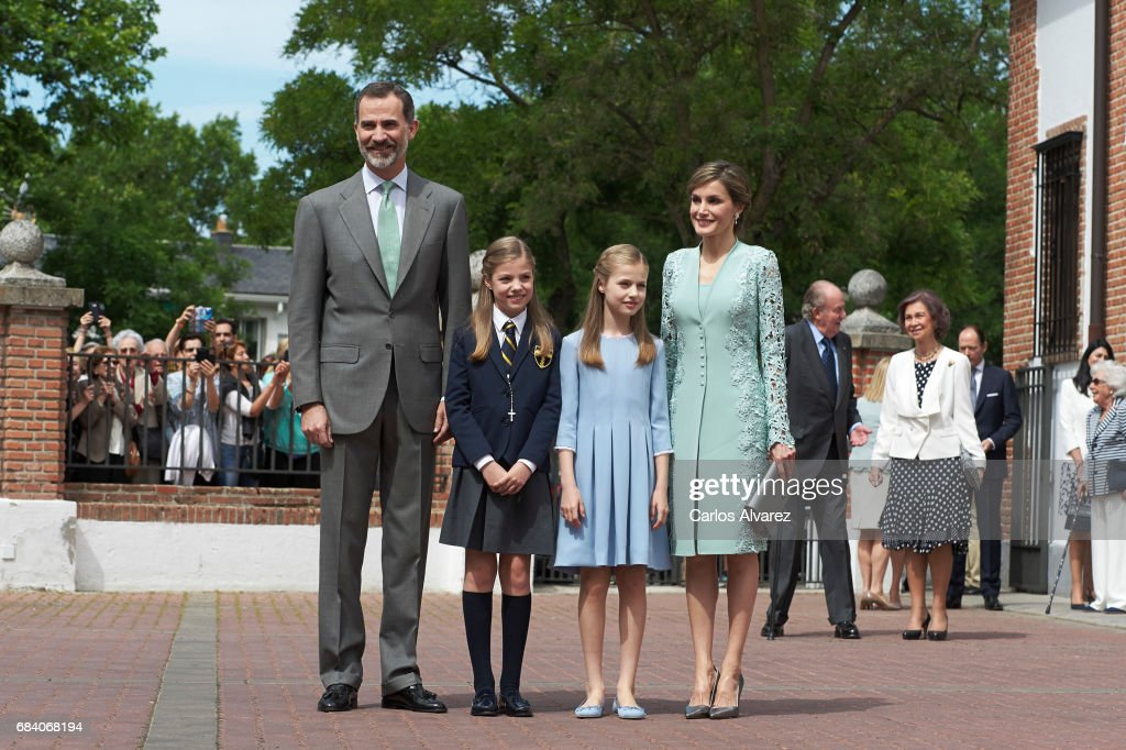 King Felipe VI of Spain, Princess Sofia of Spain, Princess Leonor of Spain and Queen Letizia of Spain pose for the photographers after the First Communion of Princess Sofia of Spain at the Asuncion de Nuestra Senora Church on May 17, 2017 in Madrid, Spain.
