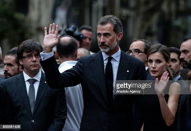 King Felipe VI of Spain Queen Letizia and President of the Catalan government Carles Puigdemont attend a memorial at La Rambla boulevard for the...