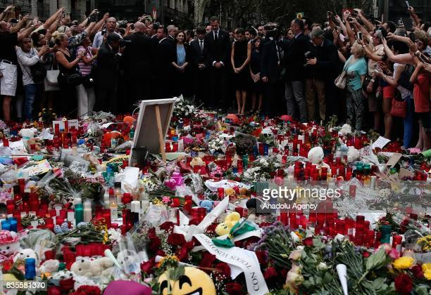 King Felipe VI of Spain Queen Letizia and the mayor of Barcelona Ada Colau light candles and leave flowers at La Rambla boulevard during a memorial...