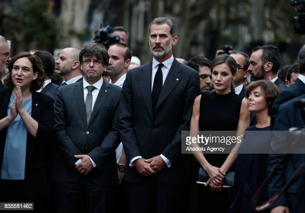King Felipe VI of Spain Queen Letizia President of the Catalan government Carles Puigdemont and the mayor of Barcelona Ada Colau attend a memorial at...