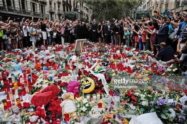 King Felipe VI of Spain Queen Letizia President of the Catalan government Carles Puigdemont and the mayor of Barcelona Ada Colau light candles and...