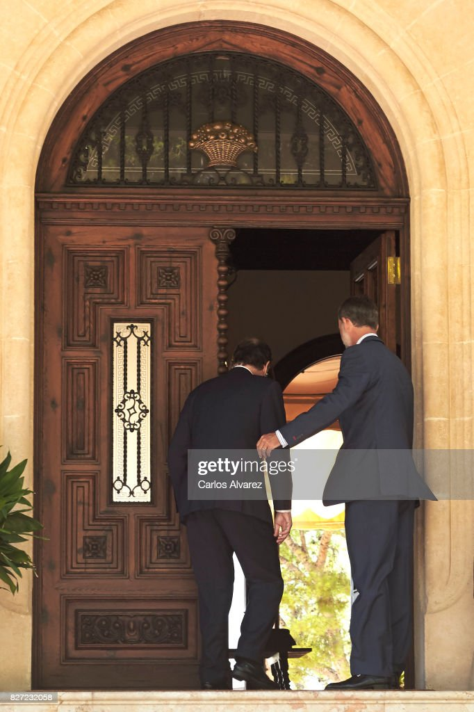 King Felipe VI of Spain (R) receives Prime Minister Mariano Rajoy (L) at the Marivent Palace on August 7, 2017 in Palma de Mallorca, Spain.