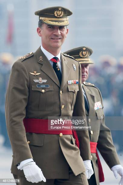 King Felipe VI of Spain receives Spain's Armed Forces and Guardia Civil during a military ceremony at the Royal Palace on June 25 2014 in Madrid Spain