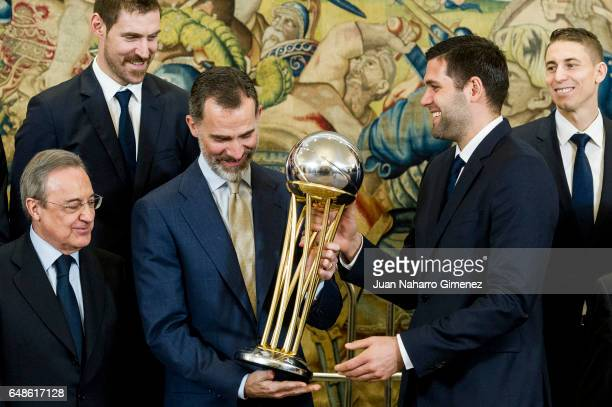 King Felipe VI of Spain receives the basketball team of Real Madrid CF champion of the 81st edition of the SM the King at Zarzuela Palace on March 6...