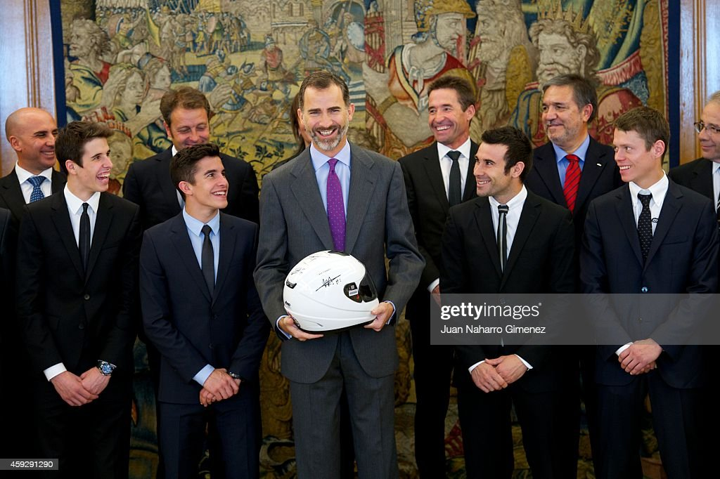 King Felipe VI of Spain (C) receives the motorcycling world champions in 2014 (L-R) Alex Marquez, Alenta Moto2 champion, Marc Marquez, Alenta MotoGP champion, Toni Bou, Trial champion and Esteve Rabat, Moto3 champion at Zarzuela Palace on November 20, 2014 in Madrid, Spain.