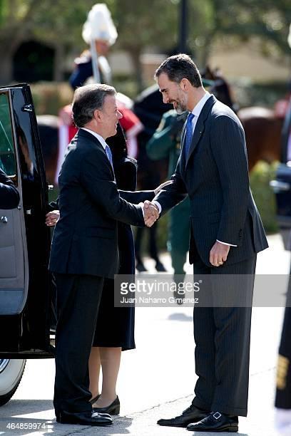 King Felipe VI of Spain receives the President of Colombia Juan Manuel Santos at El Pardo Royal Palace on March 1 2015 in Madrid Spain