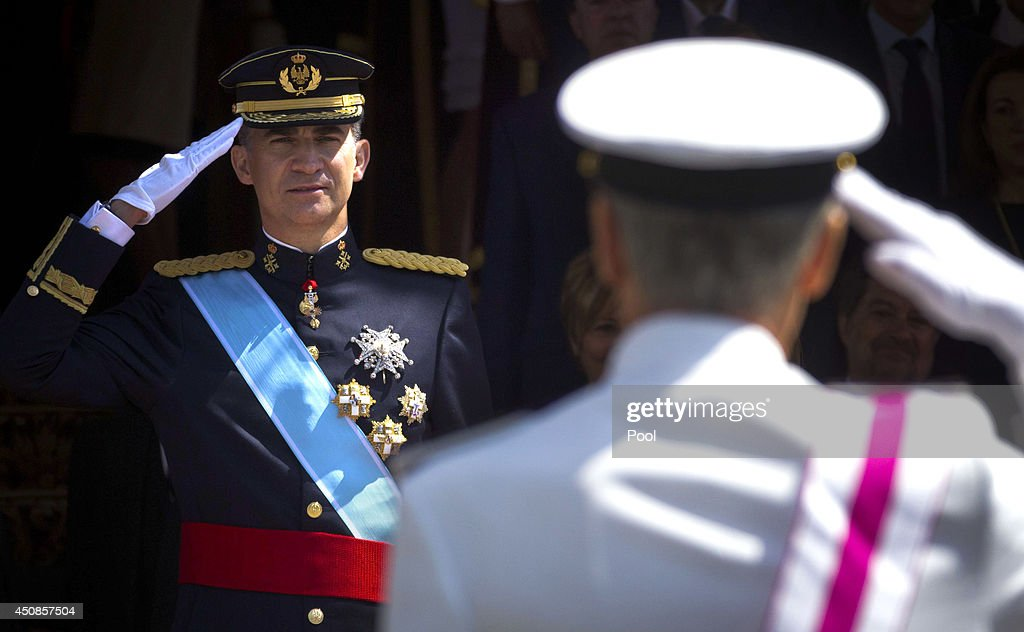 King Felipe VI of Spain salutes a military parade at the doors of Congress after his proclamation, on June 19, 2014 in Madrid, Spain. The coronation of King Felipe VI is held in Madrid. His father, the former King Juan Carlos of Spain abdicated on June 2nd after a 39 year reign. The new King is joined by his wife Queen Letizia of Spain.