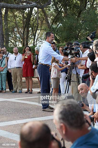 King Felipe VI of Spain shakes hands with media press at the Marivent Palace on August 3 2015 in Palma de Mallorca Spain