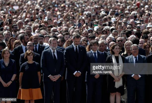 King Felipe VI of Spain Spanish Prime Minister Mariano Rajoy and the President of the Catalan government Carles Puigdemont attend a remembrance at...