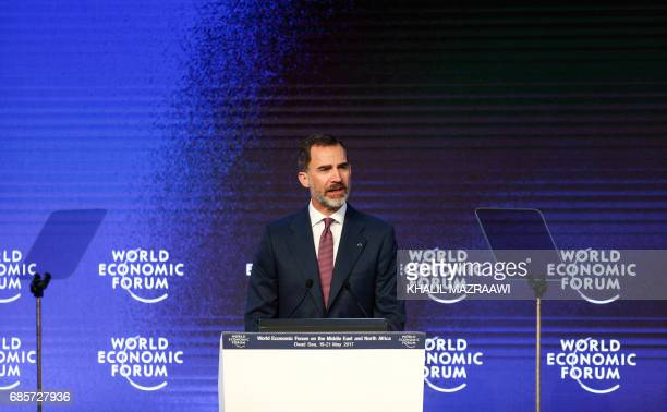 King Felipe VI of Spain speaks on the stage during the opening session of the World Economic Forum held in the Dead Sea resort of Shuneh west of the...