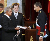 King Felipe VI of Spain swears an oath as King of Spain to the Spanish Parliament in the presence of President of the Congress of Deputies Jesus...