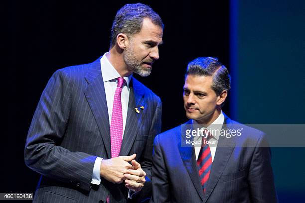 King Felipe VI of Spain talks with Mexican President Enrique Peñ–a Nieto during a cultural event as part of IberoAmerican Summit 2014 at Teatro de la...