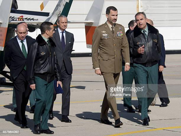 King Felipe VI of Spain visits the Aerial service of the Civil Guards at INTA on October 28 2014 in Torrejon De Ardoz Spain