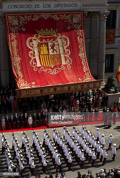 King Felipe Vl his wife Queen Letizia of Spain and Felipe's children Leonor and Sofia watch a milirary parade after he was sworn at the Spanish...