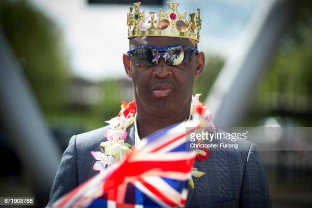 King for the day a man watches the Manchester St George's Day parade through the streets on April 23 2017 in Manchester England Various parades have...