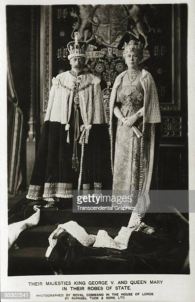 King George V and Queen Mary appear on a photo postcard by Tuck of London in their coronation robes during a ceremonial photo session London 1911