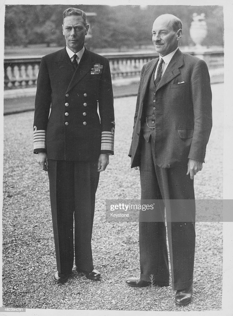 King George VI and Prime Minister Clement Attlee posing for a photograph on the steps of Buckingham Palace following a meeting London July 28th 1945