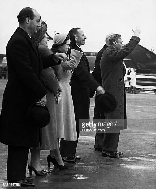 King George VI and Queen Elizabeth of England and Princess Margaret along with officials wave farewell to Princess Elizabeth and her husband the Duke...