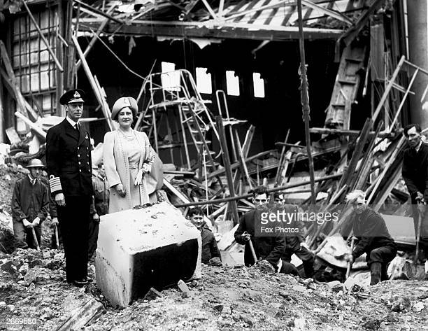 King George VI and Queen Elizabeth survey some of the damage after the bombing of Buckingham Palace London during the Second World War