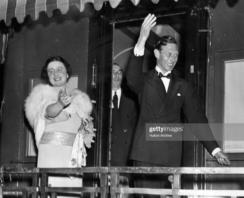 King George VI (1895 - 1952) and Queen Elizabeth (1900 - 2002) wave from the observation platform of their train as they leave America.