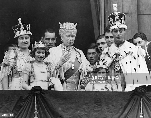 King George VI and Queen Elizabeth with Queen Mary Princesses Elizabeth and Margaret Rose and members of the extended Royal Family on the balcony of...