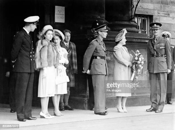 King George VI and the Queen with the Princess Elizabeth and Princess Margaret on arrival at Holyrood With the royal family can be seen Lt Philip...
